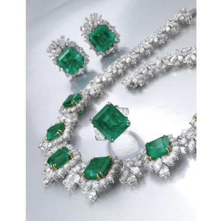 Impressive Emerald and diamond necklace and a pair of ear clips and a ring from the collection of Lily Marinho. photo Sotheby's
