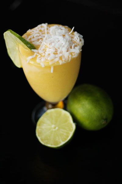 Mango Coconut Daiquiri:  1c frozen mango chunks  1/4c mango juice   1/4c coconut milk  1/4c light rum   juice of 1 lime  Combine all ingredients in a blender.  Pulse until smooth & combined.  Pour daiquiris into glasses, garnish w/ shredded coconut & a slice of lime. CHEERS!