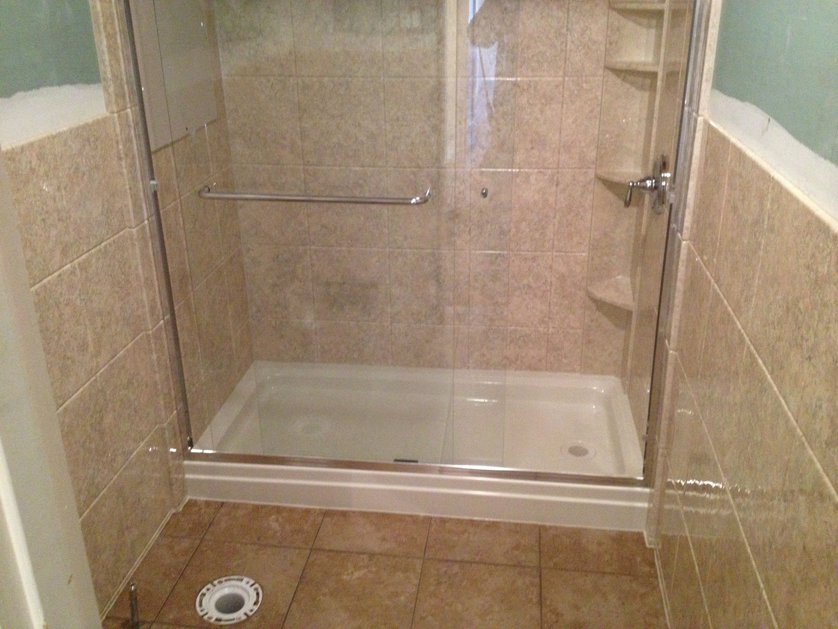 Turning an unused bathtub into a walk-in shower can have several ...
