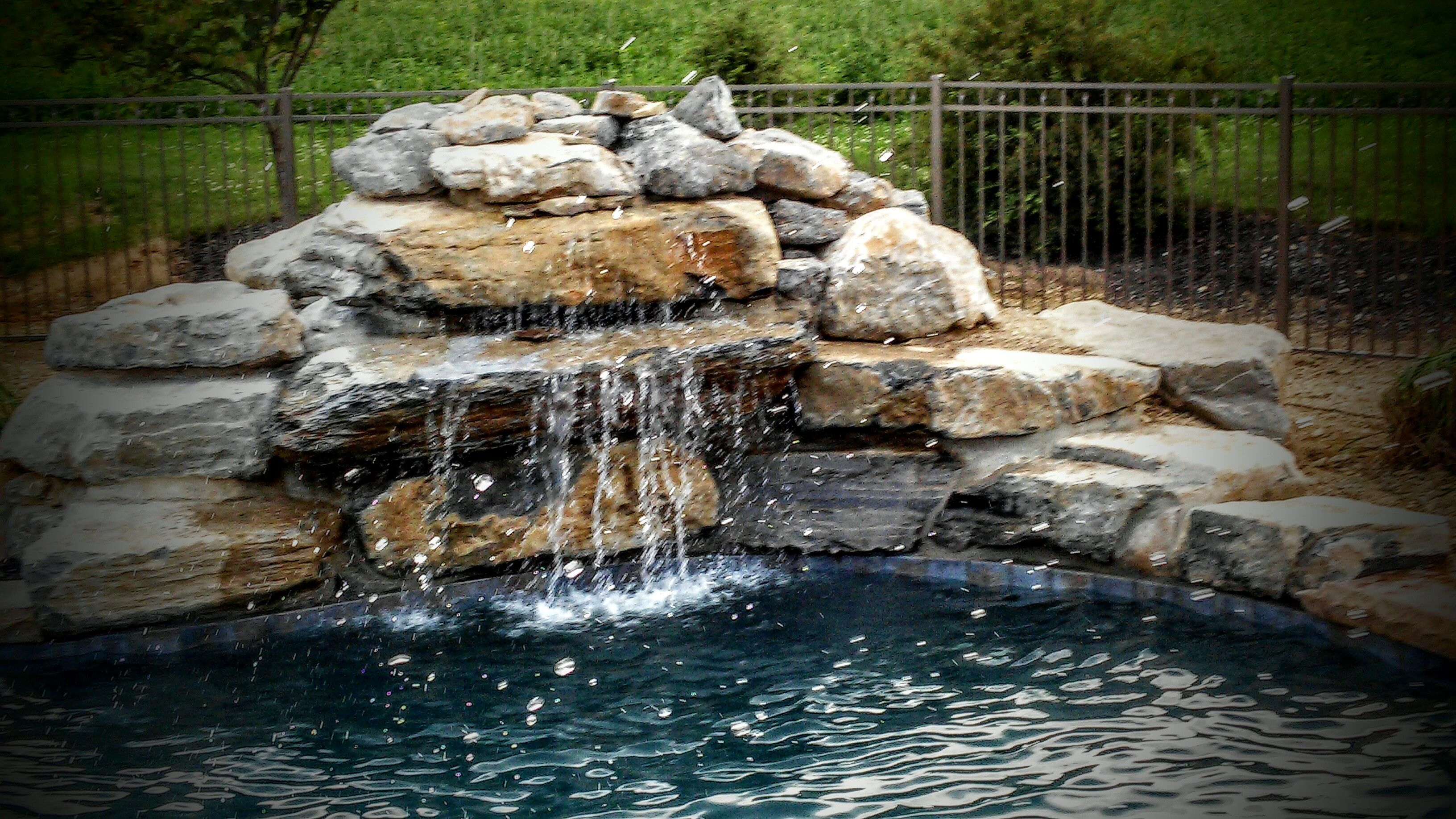 Front garden features  pool waterfall and coping limestone boulders  Front garden