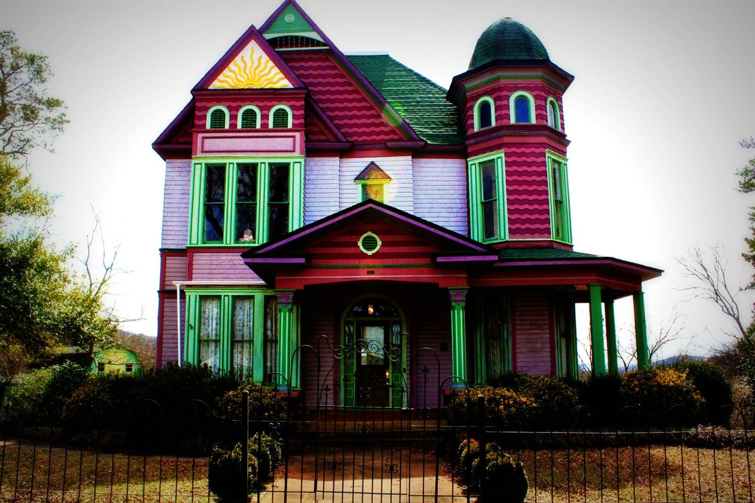 Victorian home plantation house vintage colorful pink purple green yellow blue pink vintage old southern alabama