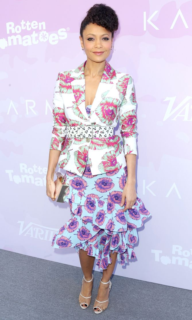 THANDIE NEWTON dons a bold floral dress under a bold floral blazer and bold floral belt (all Altuzarra)with Charlotte Olympia heels and a Vince Camuto clutch