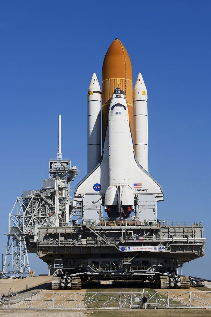 Space Shuttle Discovery Rolls Out To Launch Pad Weeks Before Launch Space Shuttle Space Travel Kennedy Space Center