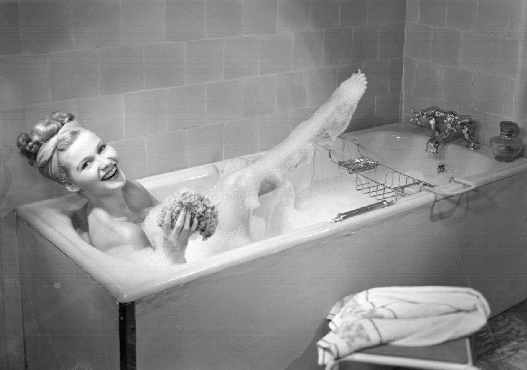 1920s-1930s Young Brunette Woman Sitting In Luxury Bathtub