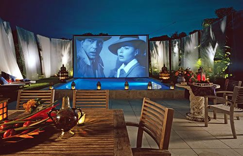 Outdoor movie theater with gauze curtains on the terrace for Terrace theater movies
