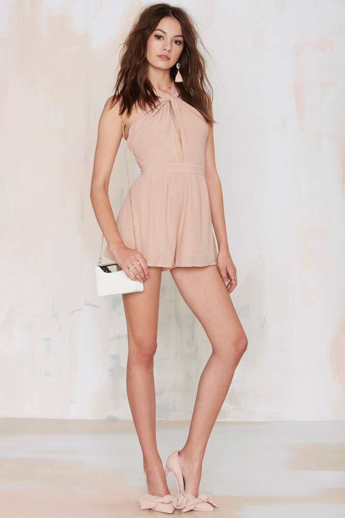 The NBD Got Me Twisted Crepe Romper is the perfect blush to make 'em blush.