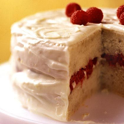 Banana-Raspberry Cake with Lemon Frosting  Mashed ripe bananas mixed into the batter make this cake extra moist. The cream cheese icing, flavored with lemon zest and vanilla extract, serves as the base layer for the fresh raspberry filling and the outer frosting.