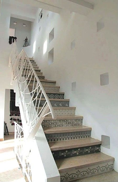 """Use paint and stencils to give stairs a new look.      """"I love it when great design pops up in the most unexpected places,"""" saysMoggit blogger Joy Zaczyk. """"These unique Moroccan stair stencils provide visual interest and make these stairs the undeniable star of the room."""""""
