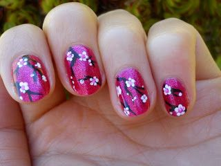 Cherry blossoms! Have just 1 nail (ring finger on each hand) with this design. Change to blue to match theme. Rest of nails 1 complimenting colour.