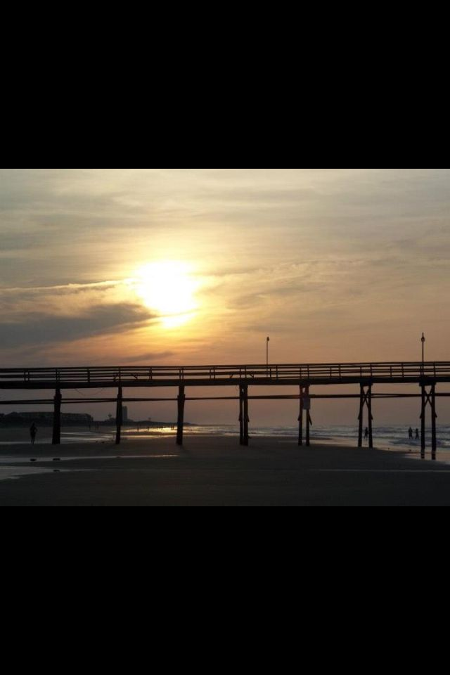 The sunrise behind the Pier at Sunset Beach North Carolina