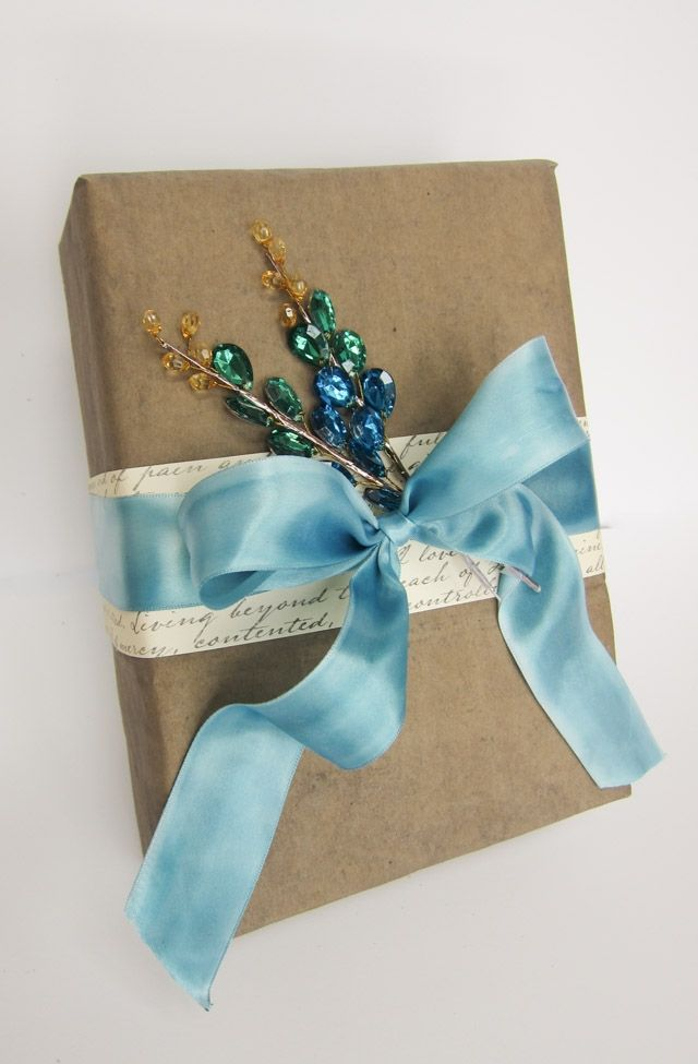 Love this simple kraft paper gift wrap colorful decorative ribbon also like the word