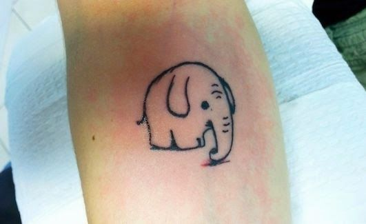 Black Color Small Elephants On Ankle Or Foot Tattoo