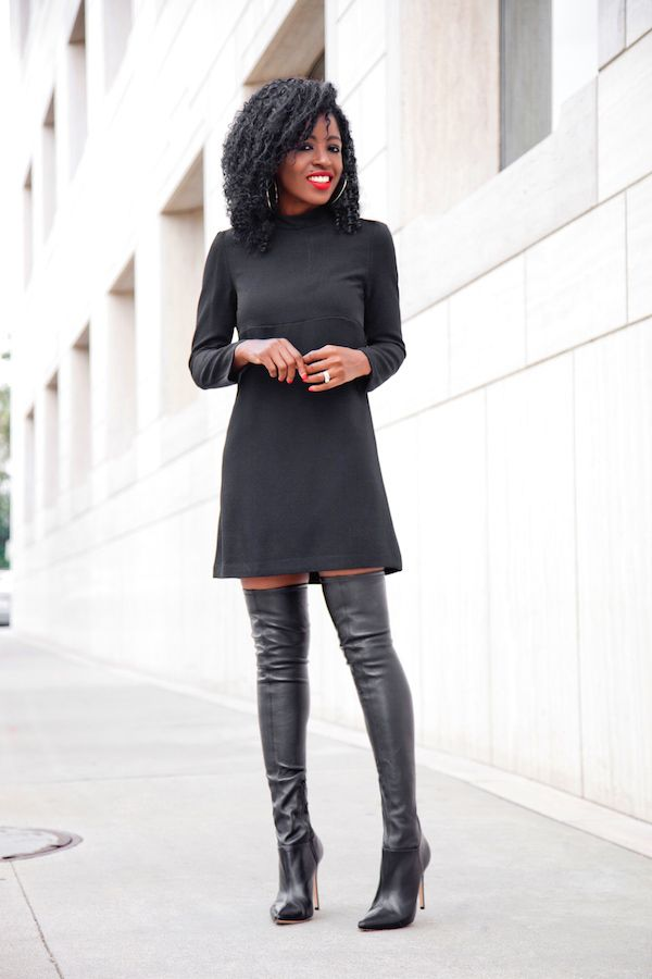 black thigh high boots on bare legs with a short dress