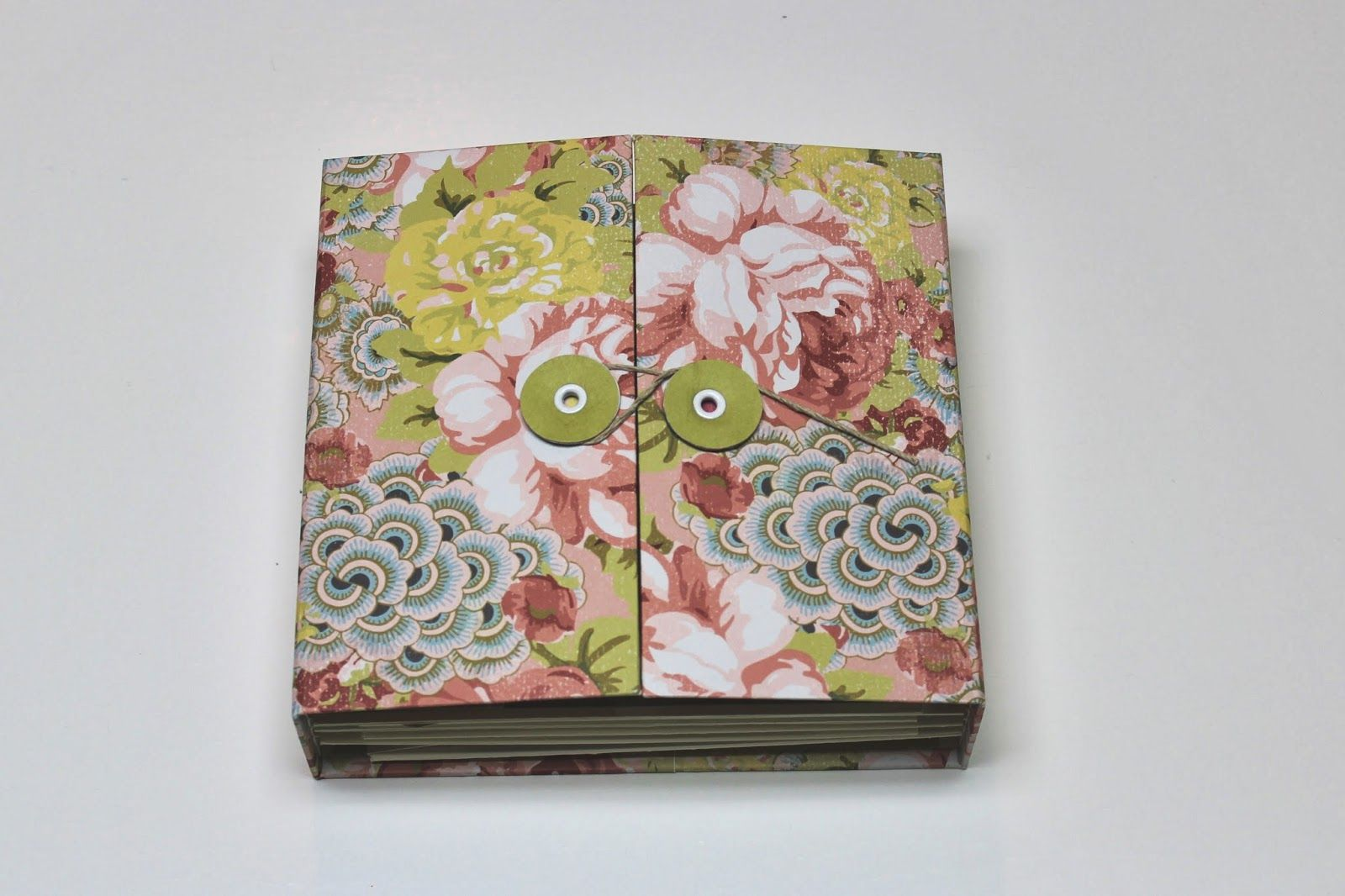 A gatefold style mini album made with pretty floral paper, chipboard and cardstock.