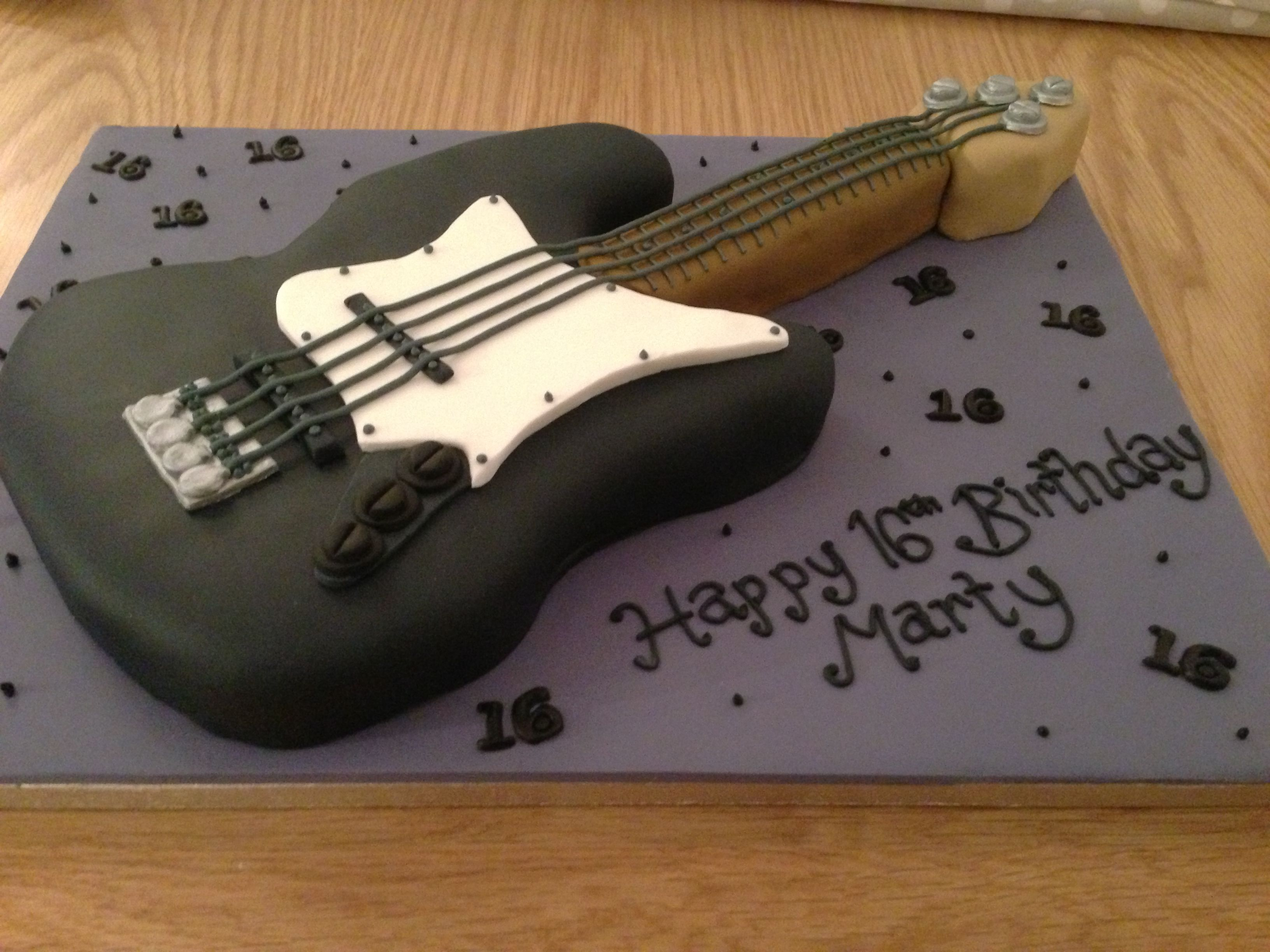 16th birthday guitar shaped cake for the hubby. Black Bedroom Furniture Sets. Home Design Ideas