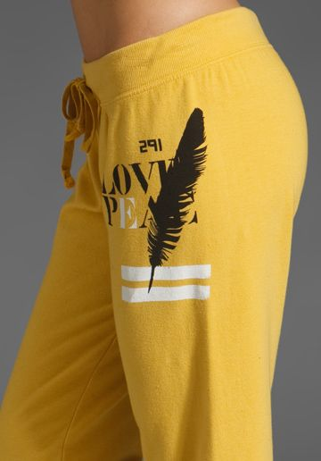 Oooh. Sweatpants with a feather...jealous.