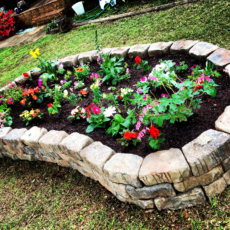 Boulder edged raised flower beds | Abode - yard | Pinterest ...