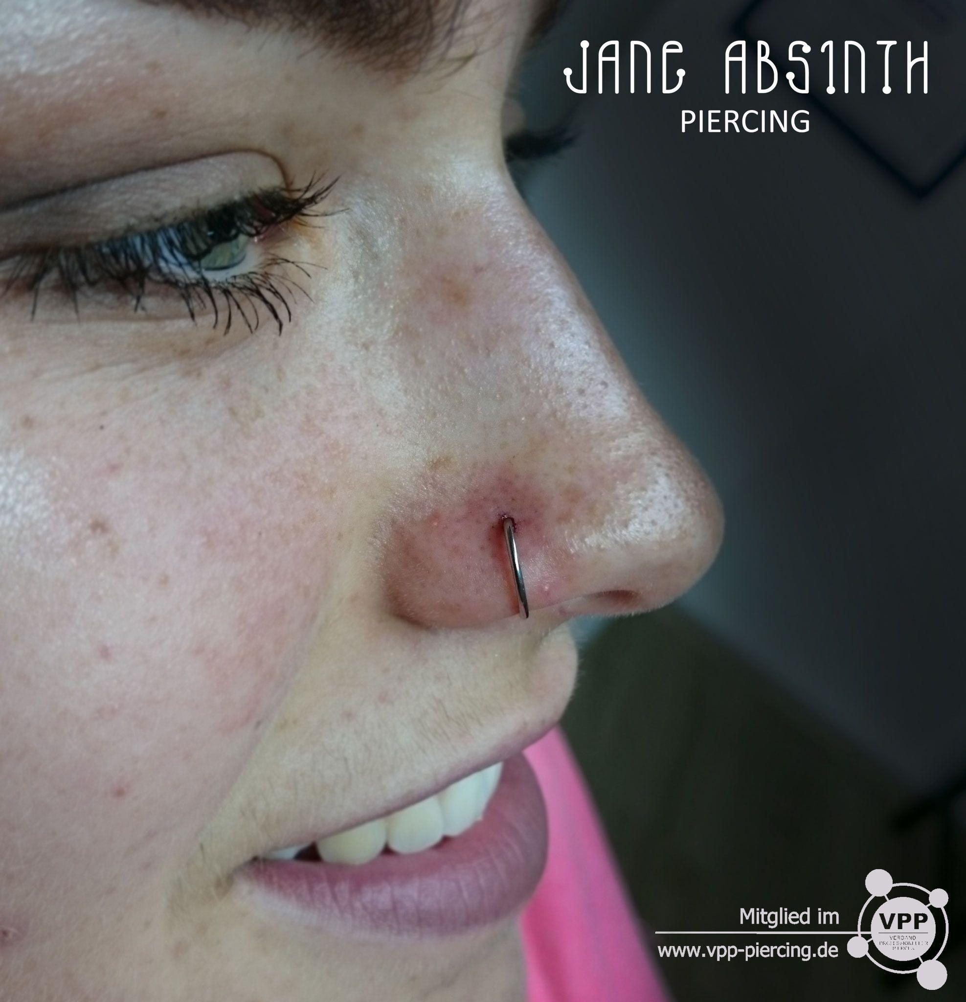 Piercing between nose and lip  Nasenflügelpiercing mit dem DRing aus Titan welcher als