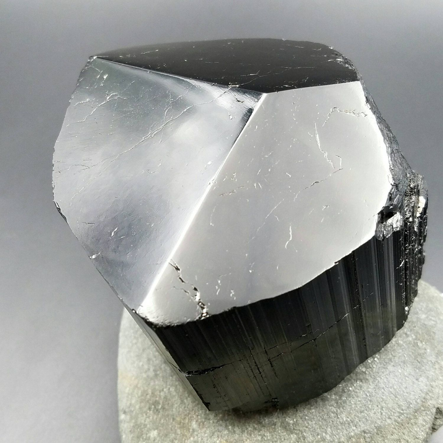 This listing is for one premium extra large BLACK TOURMALINE crystal. This terminated specimen is a collectors item of stunning quality with glossy shine that does not compare to the rough type of black tourmaline on the market.  Black Tourmaline is a excellent protection and grounding crystal. It is also known as Schorl. Black tourmaline has unique properties of being pyroelectric and piezoelectric. Black tourmaline also has a trigonal crystal structure with a Mohs hardness of 7 to 7.5…
