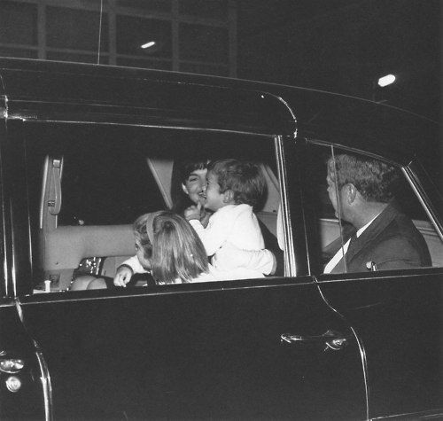 A delighted Jackie Kennedy greets her husband and children at Dulles International Airport in Washington after her return from a recuperative vacation in Greece, aboard Greek shipping tycoon Aristotle Onassis' yacht Christina.