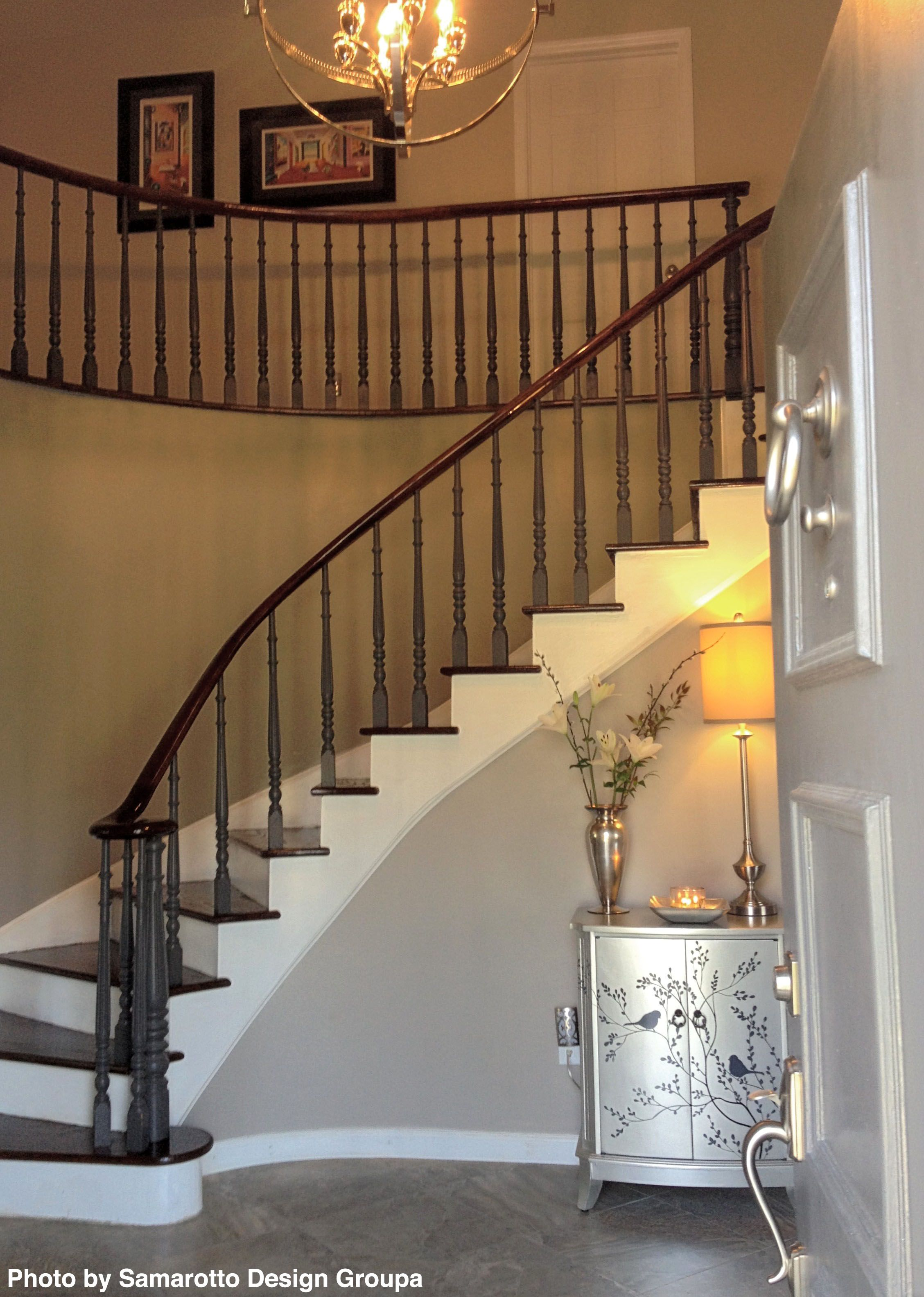 Transitional Curved Staircase With Stained Wood Stairs, Tile Entry Floor And  White Painted Millwork. Tile And Hardwood Do Go Well Together.