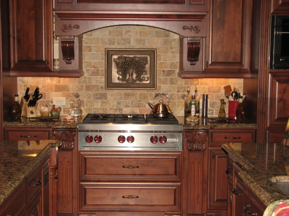 Kitchen floor tiles that match cherry wood cabinets for Spanish style kitchen backsplash