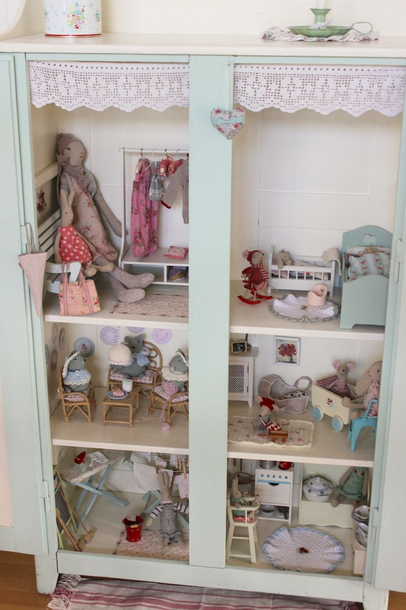 A cabinet turned into a doll house