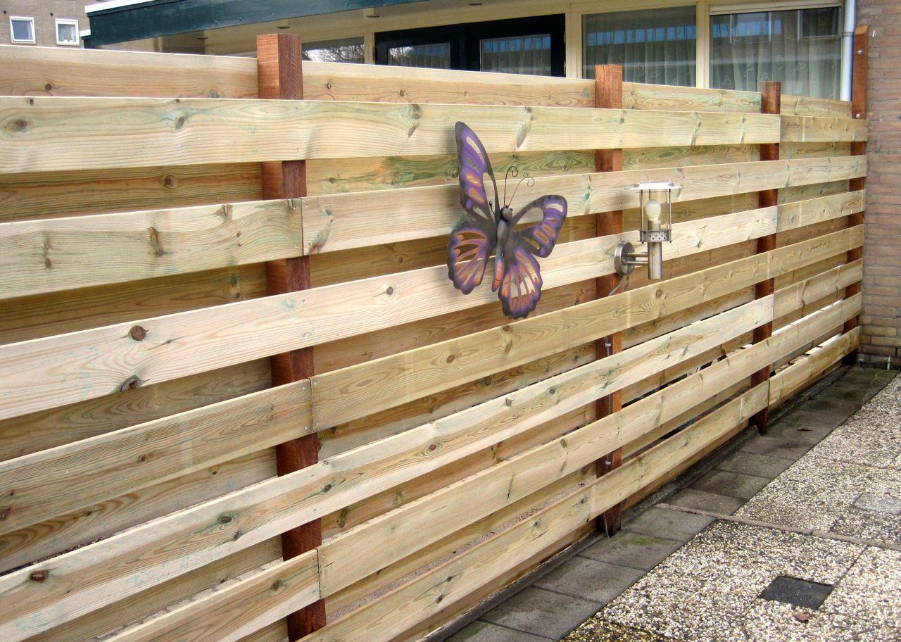 Schutting van horizontale geimpregneerde planken met hardhouten palen  Gadero Productnr  DE3534