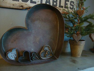 I have a large copper heart, very much like this, made by Michael Bonne in the 1980s. -- Tana