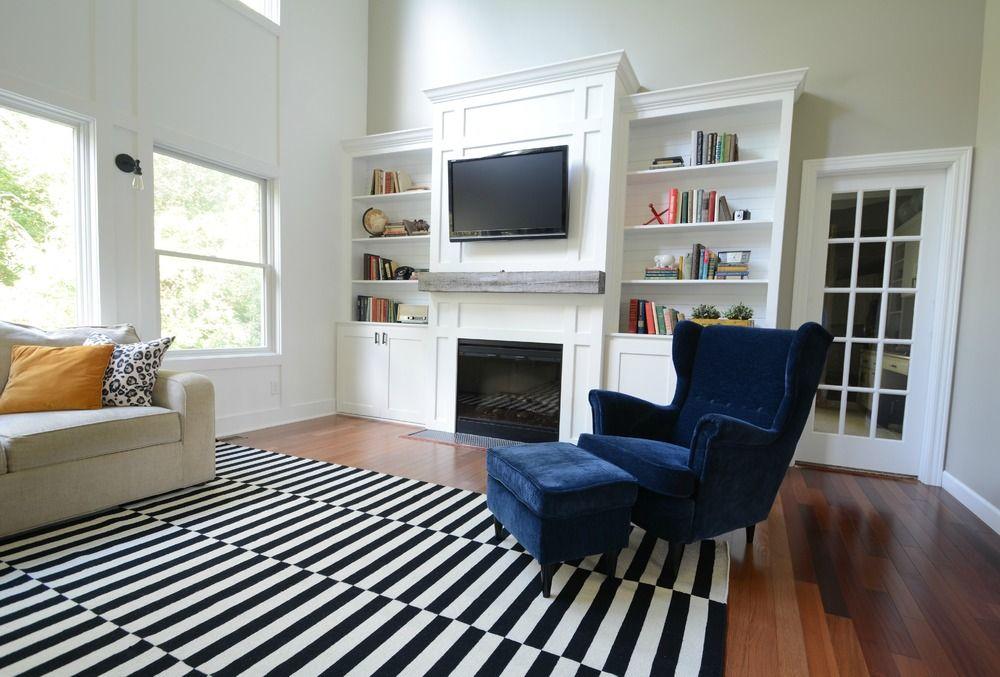 Living Room Updates Ikea Stockholm Rug Black White Navy Barn Beam Mantel Built Ins Books