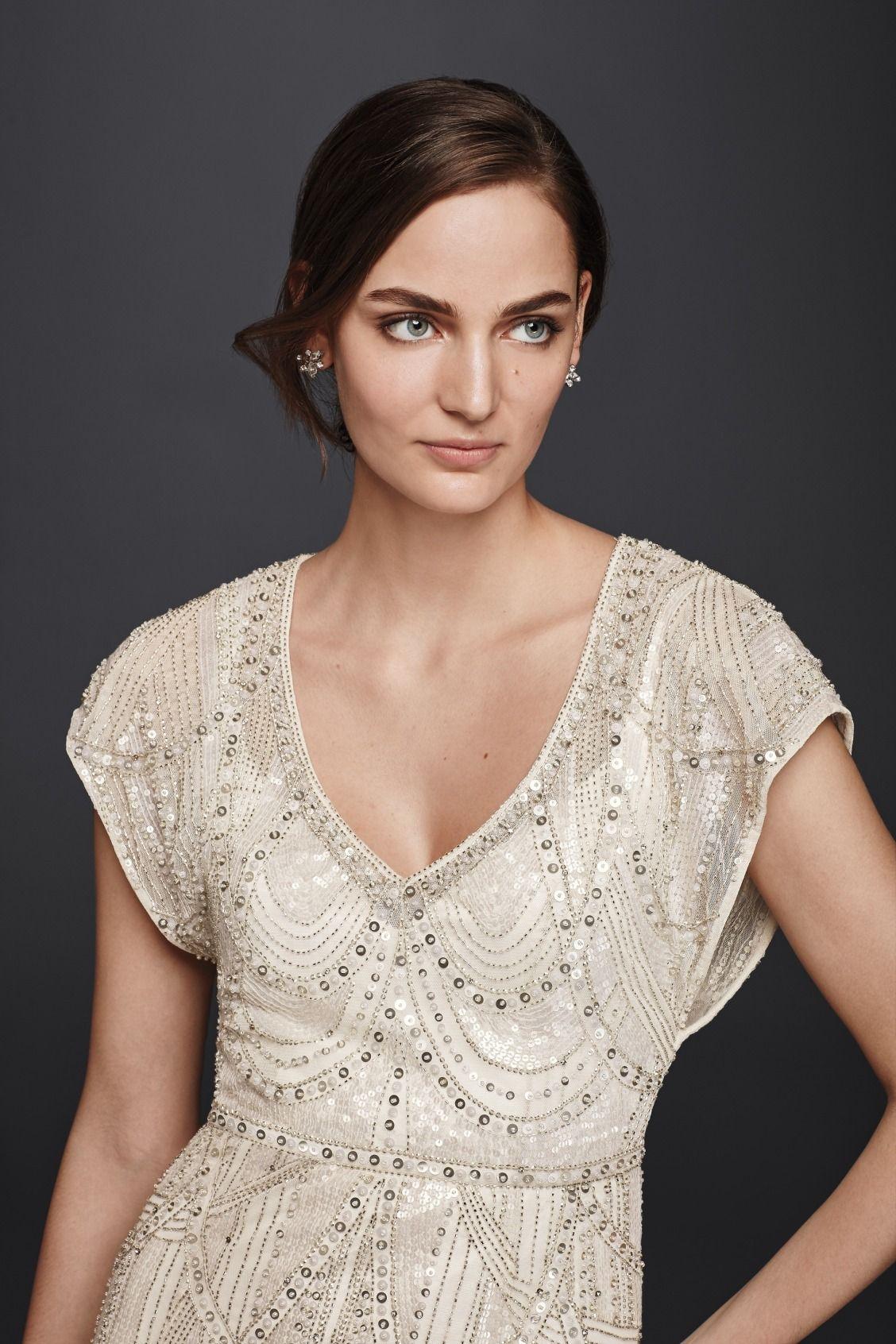 Jenny Packham Signature Beading Creates A Vintage Inspired Pattern Across The Short Sleeve Blouson Bodice Of This Mesh Sheath Wedding Dress