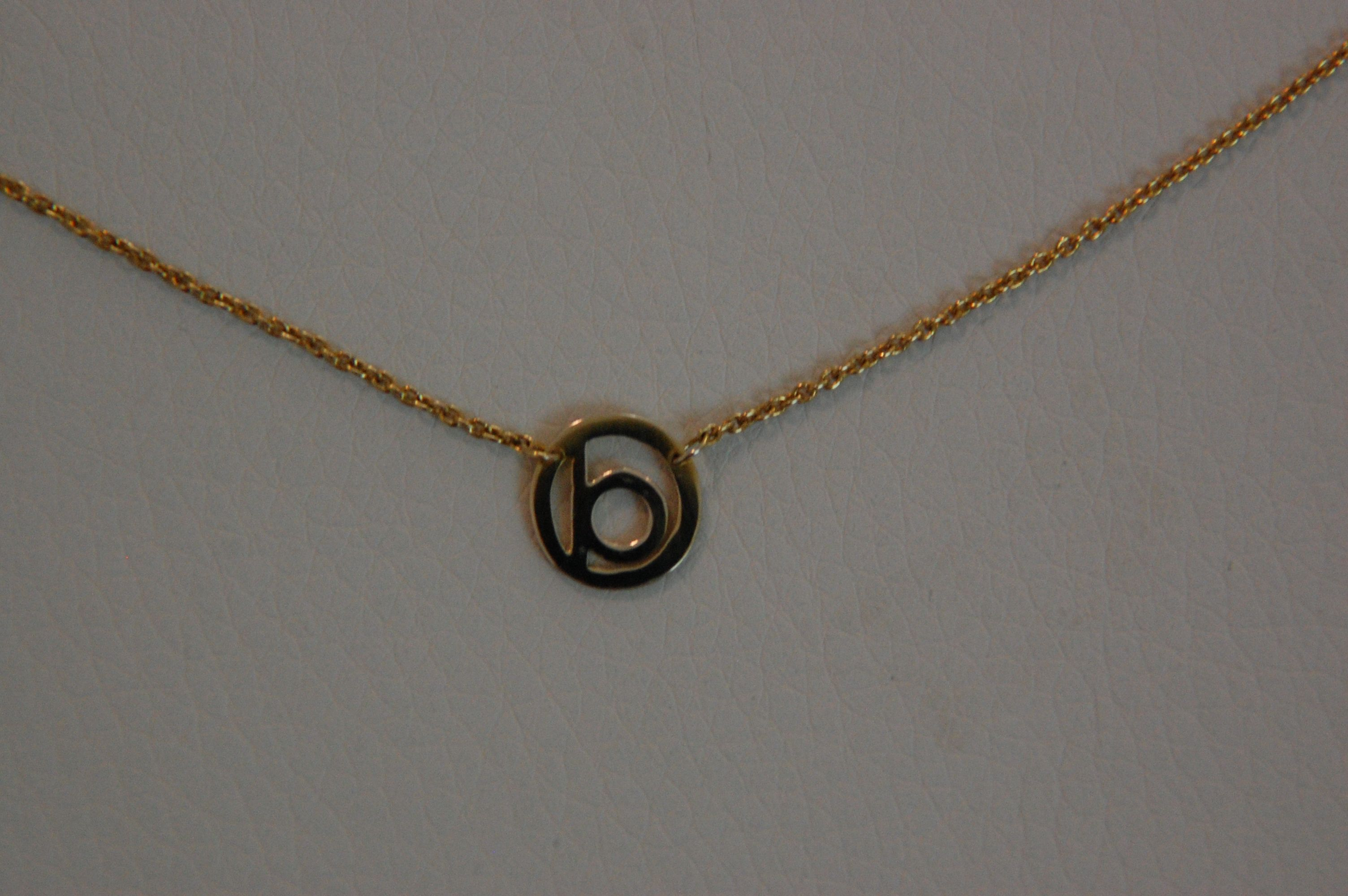 o designs makes custom made personalized jewelry 14k gold silver