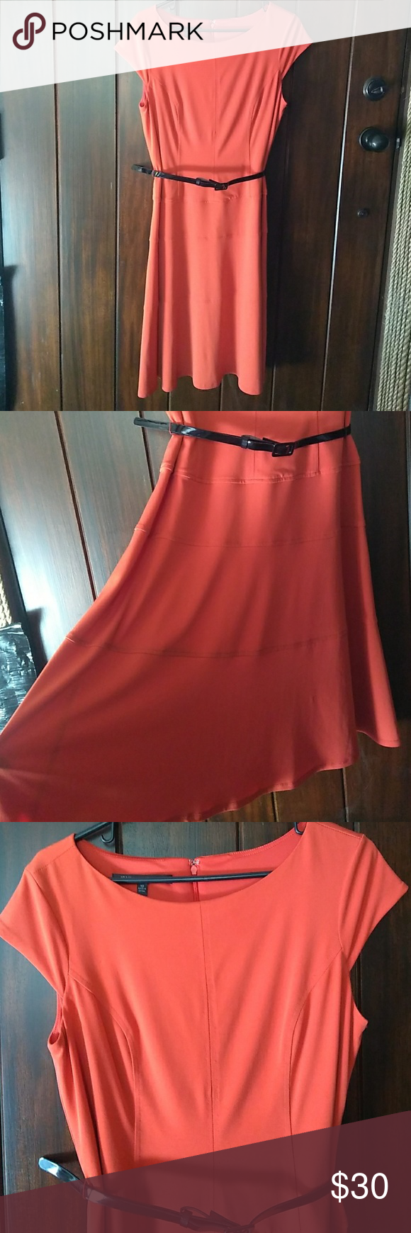 """Jones Wear Dress Orange A-Line Dress Jones Wear Dress Orange A-Line Dress, size 10. Tiered skirt. Back zip. Comes with black belt. Top part lined. Mostly polyester with some spandex for fit and comfort. Pit to pit is 18.5"""" and length from shoulder to bottom hem is 41.5"""". VGUC, no flaws. Perfect for spring! Jones Wear Dress Dresses"""