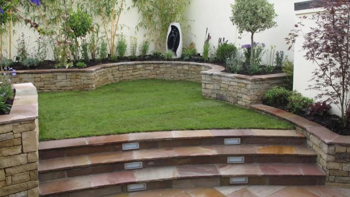 Split level garden design owen chubb garden landscapers for Small sloping garden designs