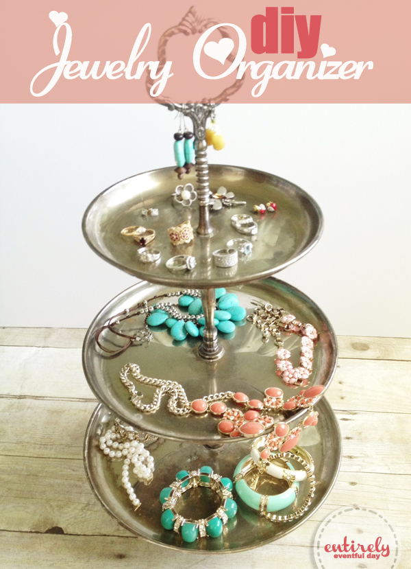Use a thrifted teared tray to organize your jewelry Why didnt I