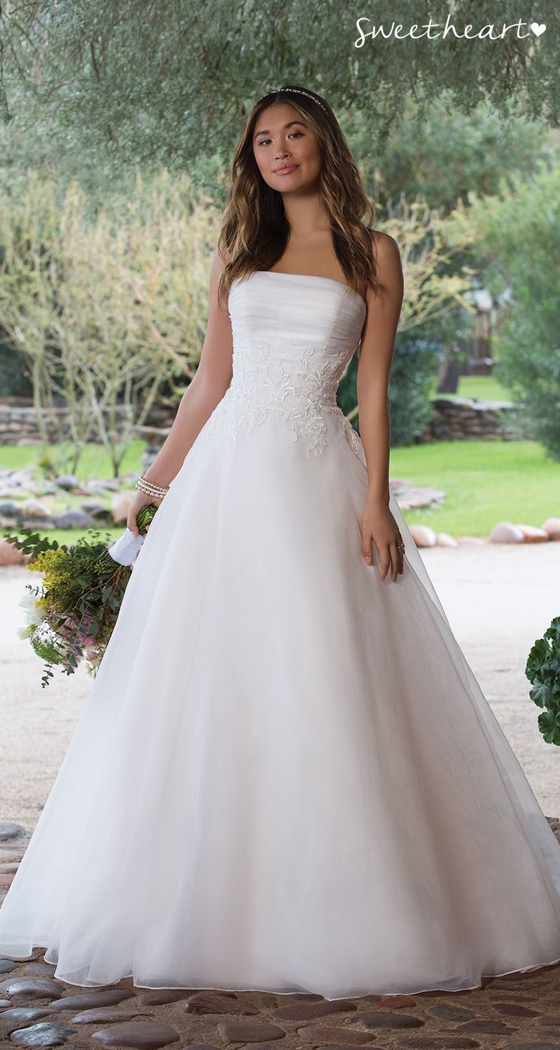 Style tulle wraps the bodice of this straight neckline wedding