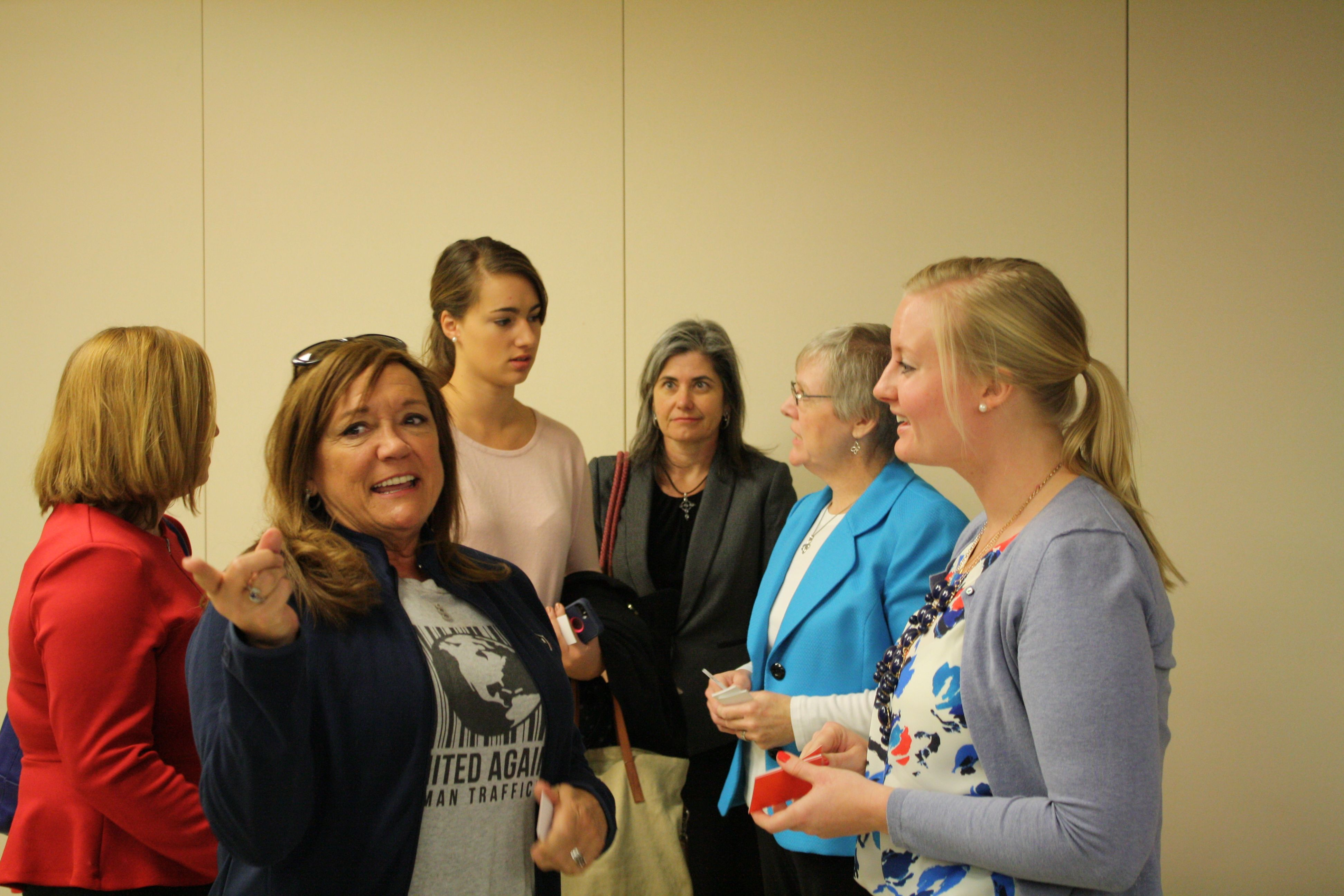 Attendees of an information session on human trafficking at First Baptist Church of Austin visit before walking to the Texas Capitol for a press conference about ending human trafficking on Thursday, Feb. 12, 2015.