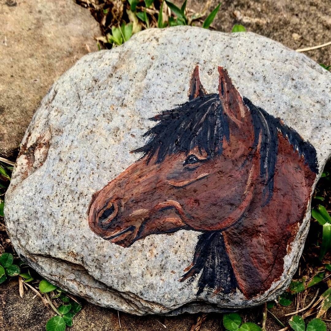 Pulled out the acrylics for the first time in over a year for a little freehand mess making on this awesome river stone a good friend found for me. Really enjoyed playing with something opaque again.  #equineartist #equineart #horseart #acrylic #acrylicpainting #stonecanvas #rockpainting #horsedrawing #horsepainting #rockart #artistsofinstagram