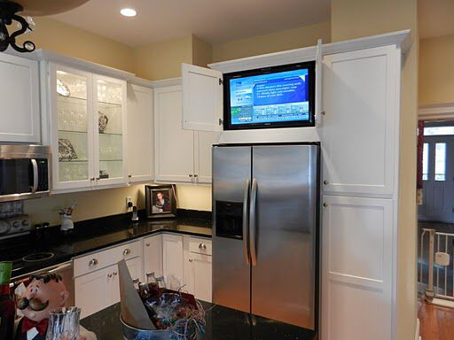 Clever Way To Have A Tv In The Kitchen But Hide It Kitchen Remodel Tv In Kitchen Home Kitchens