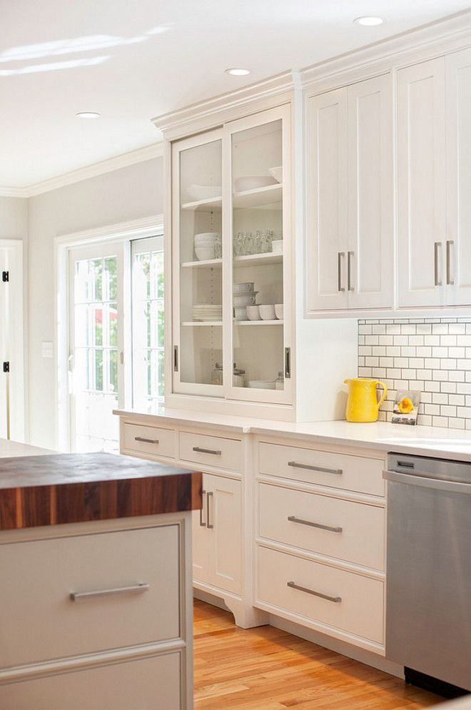 Modern Farmhouse Kitchen Designhe cabinet hardware are from the Schaub Classico Collection in a satin nickel finish. The designer used 6 1/2″ pulls on the cabinets and 8 1/2″ and 13″ pulls on the drawers.