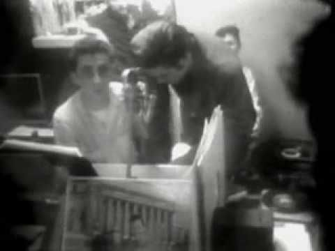 "Watch silent film footage of Elvis being interviewed by his friend, deejay George Klein, at WMC Radio Station in Memphis, Tennessee in September 1956. Elvis' actor-friend Nick Adams (""Rebel Without a Cause"") can be seen in the background."