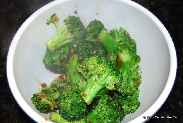 Tasty sauteed broccoli with garlic and spiced up to make this everyday recipe something special.