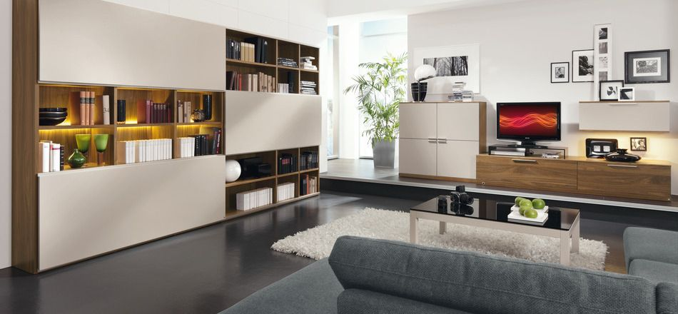 Modern Family Room With Bookcase Design White Fur Rugs Gray Fabric Sofa And  Black Flooring