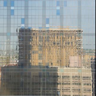 Reflection of the Elm St. Crown Plaza Hotel, Downtown Dallas, Texas.