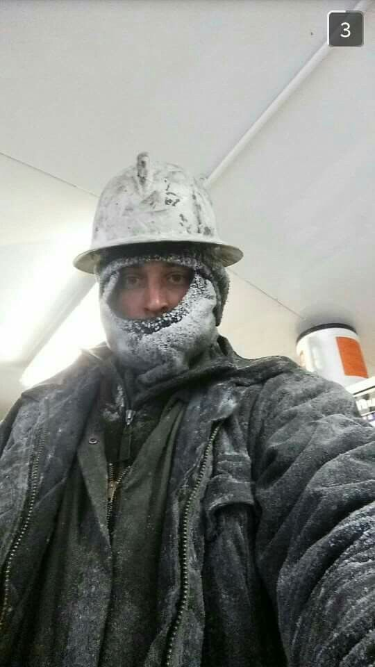 info for 30590 07bfb Oil rig worker during cold winter months in Alberta Canada.
