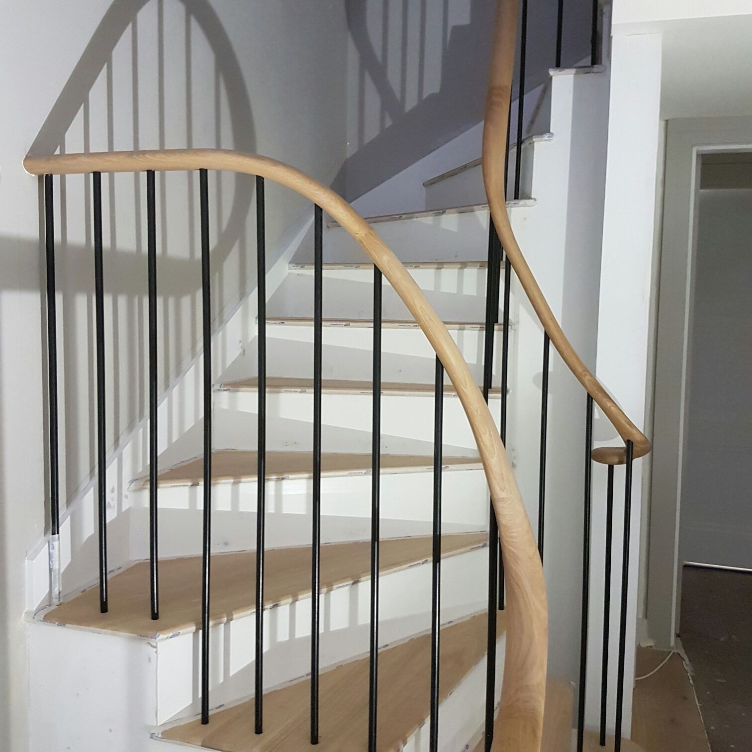 Best Slender Black Spindles With Small Oval Oak Handrail Oak 400 x 300