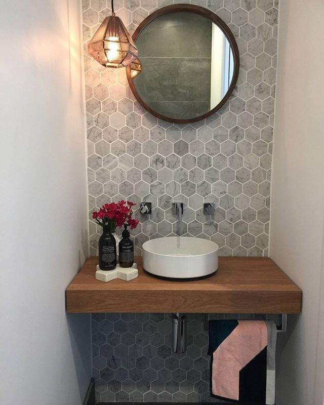 Just an accent can make a difference. This lovely powder room by @studioblackinteriors in the ACT looks perfect with all shiny chrome fittings. Complementing the Carrara marble tiles from Modern Image Tiling with a timber bench for warmth, we think this charming bathroom is just gorgeous! - #accent #ACT #bathroom #bench #Carrara #charming #chrome #Complementing #difference #fittings #Gorgeous #Image #lovely #marble #modern #perfect #Powder #powderrooms #Room #shiny #studioblackinteriors #tiles #smalltoiletroom