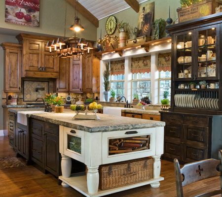 What is there not to like? Love the different cabinet heights and wood colors!