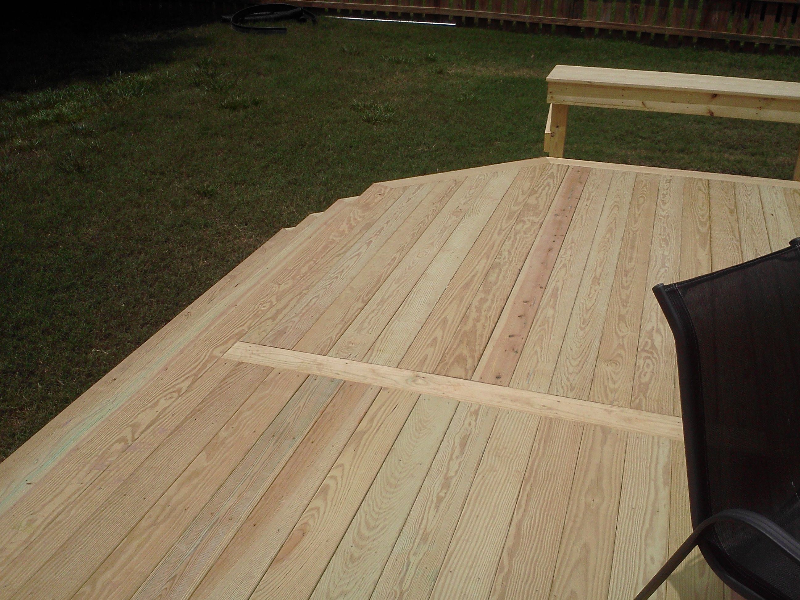 Instead Of Having Unsightly Alternating Seams For Decks Larger Than Traditional Lumber Lengths Here We Had A Woo Wood Deck Building A Deck Deck Building Cost