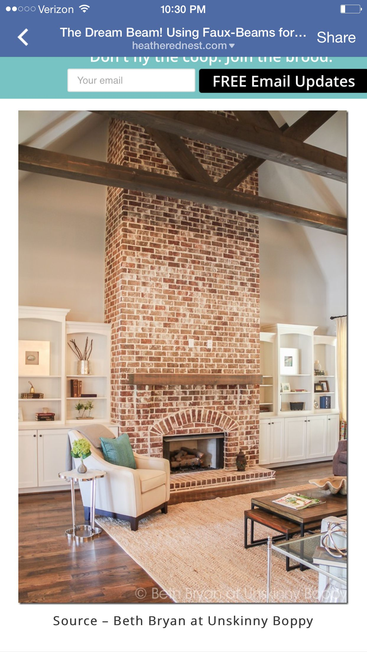 Fireplace in vaulted ceiling with wooden beams